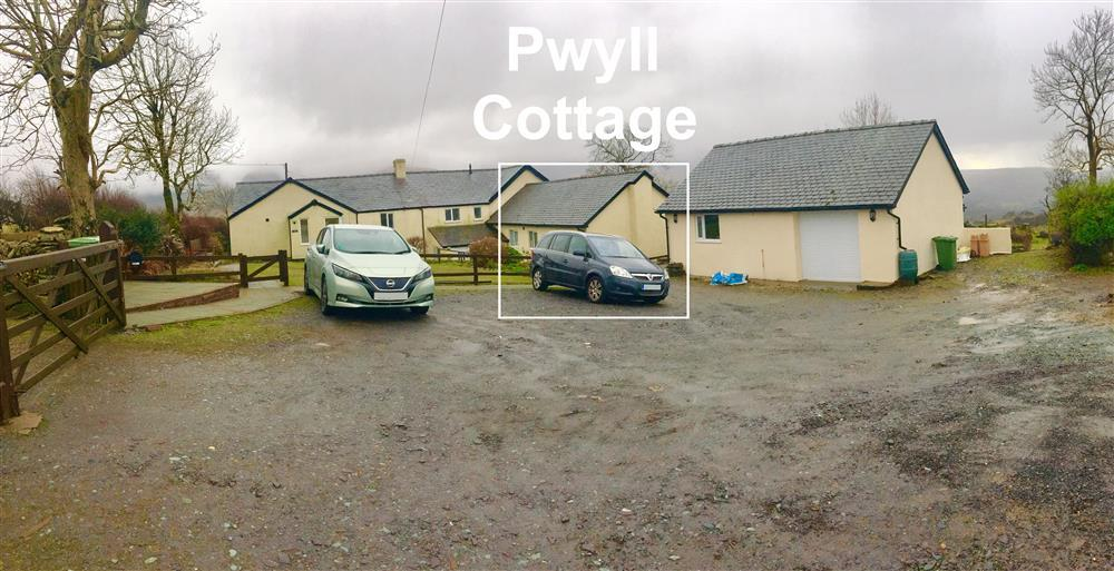 The back of Pwyll Cottage and the shared Car Park area