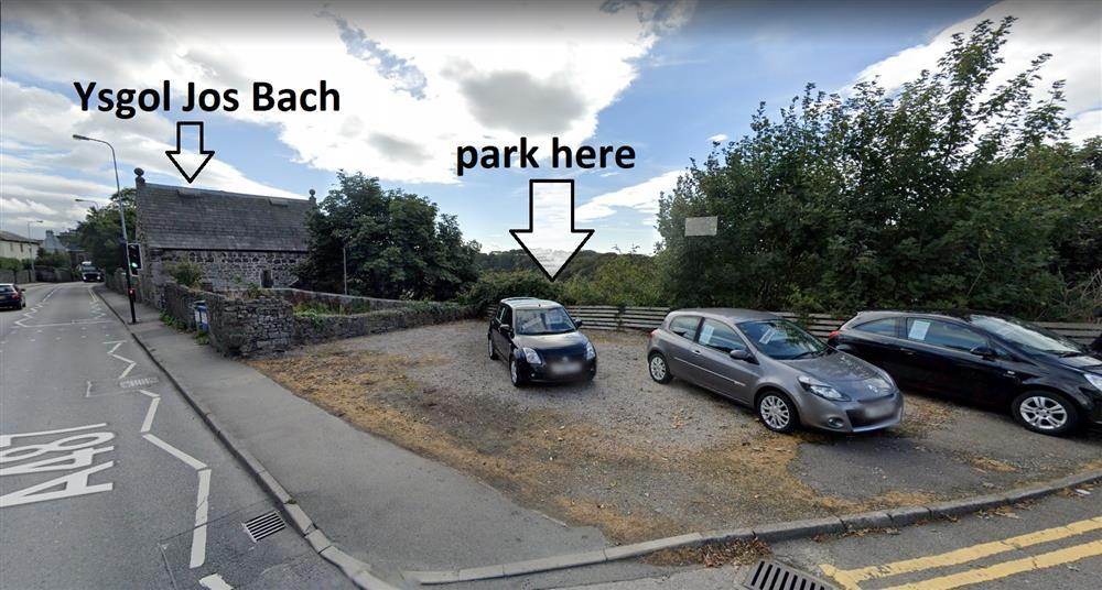 Photo of Ysgol Jos Bach from the road. The car park space for 1 car (or 2 cars head to tail) is 50m away on the land between Ysgol Jos Bach and Texaco Petrol Station.