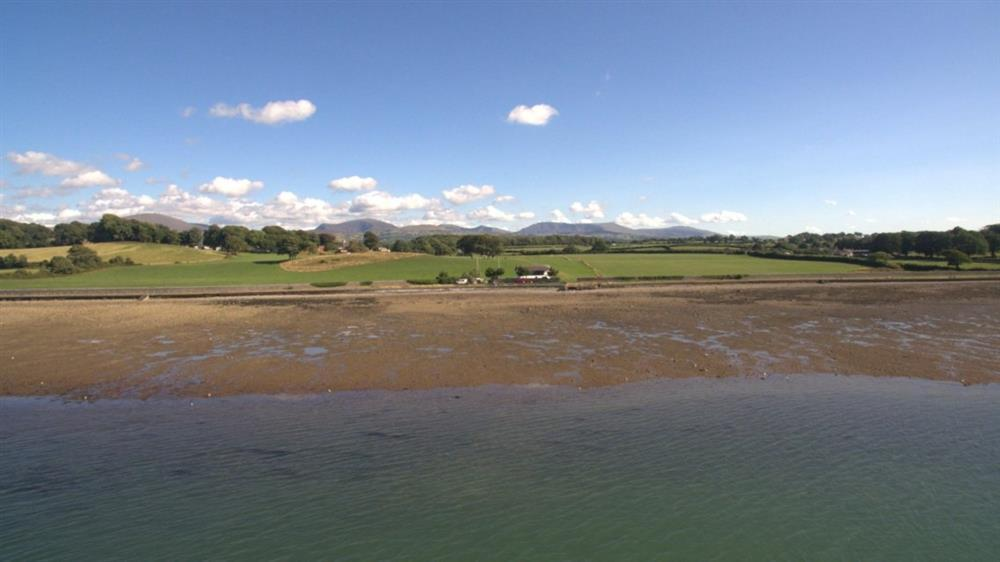 Bath Cottage - this photo was taken at low tide by a drone above the Menai Srait.