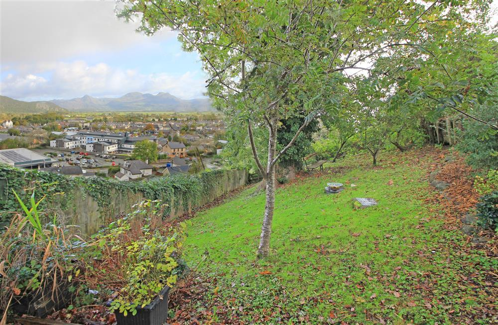 Garden with views across the harbour town of Porthmadog towards the Snowdonia Mountains. The mountains you can see are Cnicht, Moelwyn Mawr and Moelwy Bach.