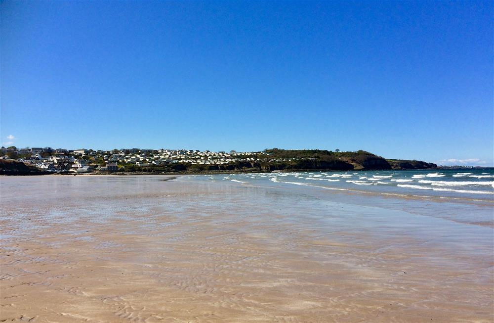 A view of village of Benllech from the Beach. Seaside Bungalow is on the hill far left in this photo
