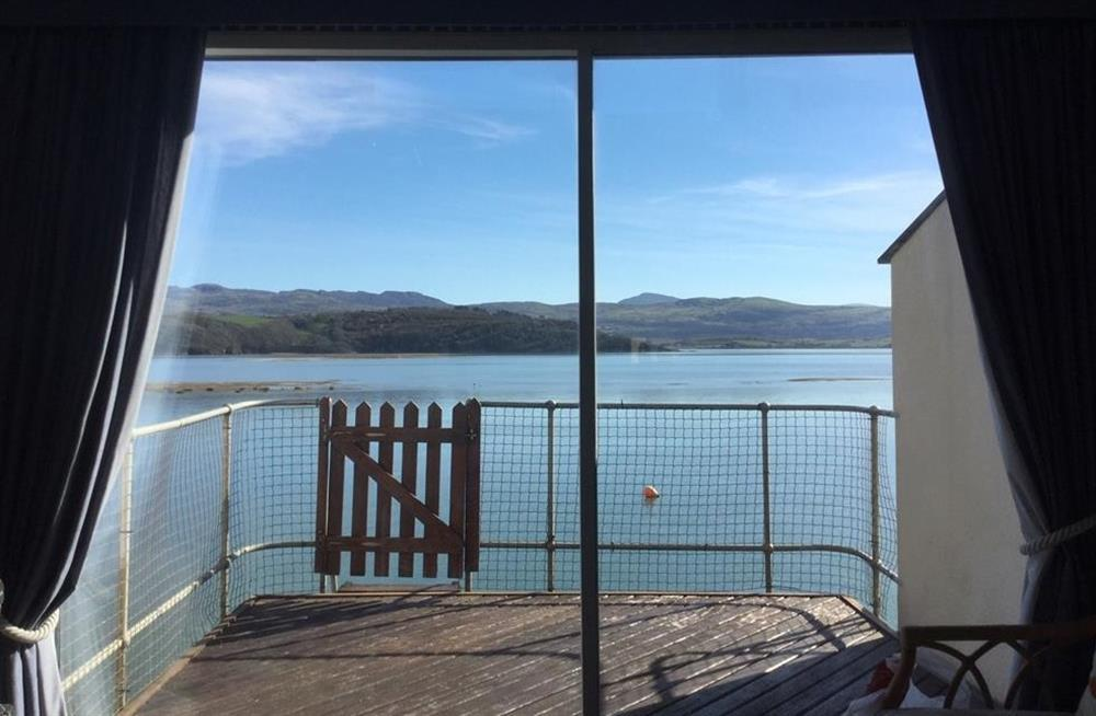 The view of the balcony and the estuary beyond at high tide (1st Floor)