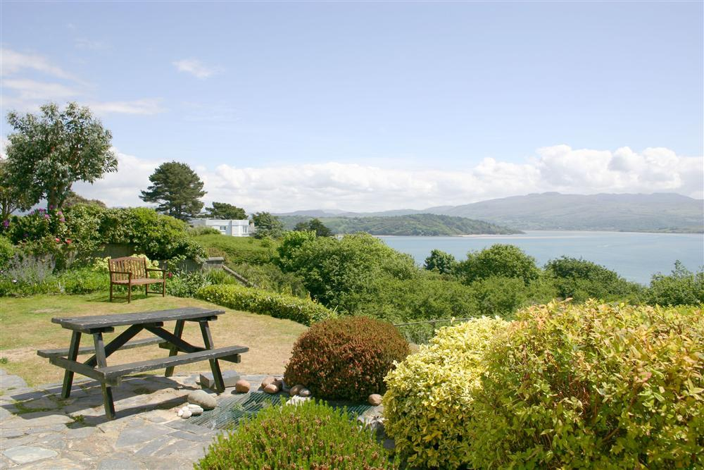 Beach House stands above the village of Borth y Gest with stunning views over the bay
