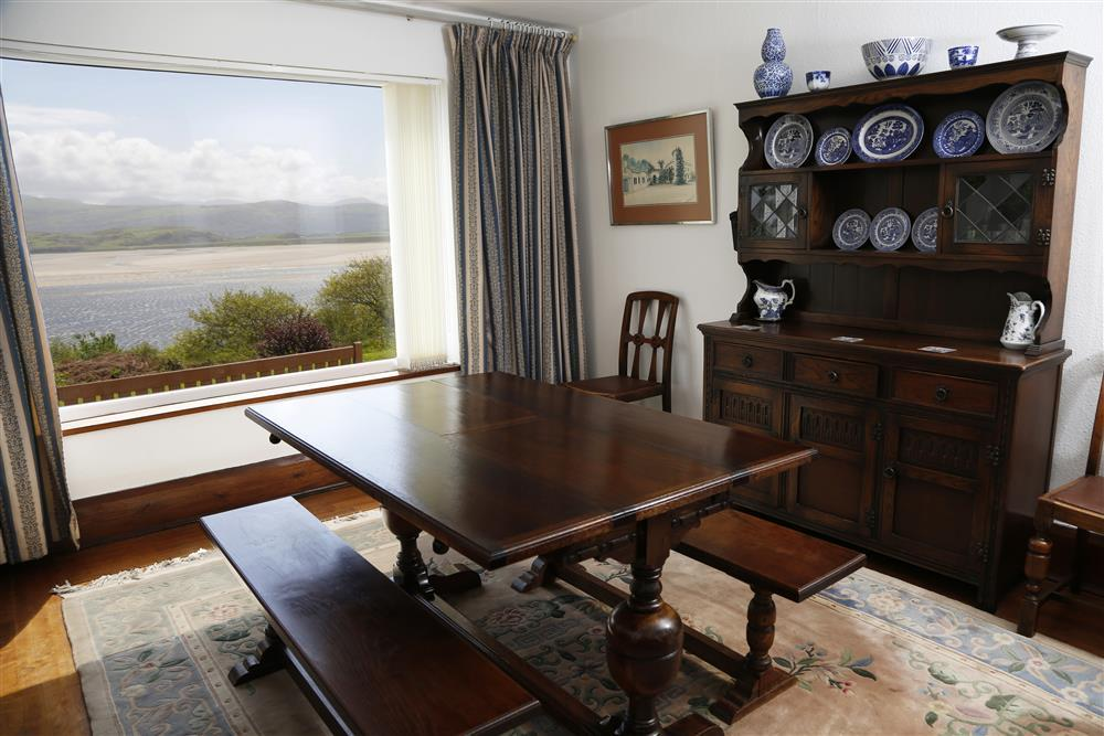 The dining area with a large picture window to enjoy the view