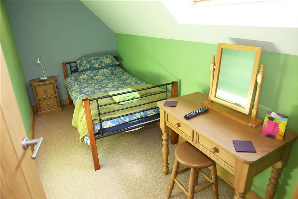 Single bedroom 2: Both single bedrooms come equipped with televisions