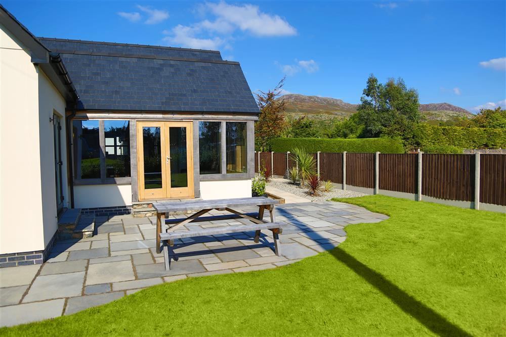 Enjoy the views from the large garden and patio area