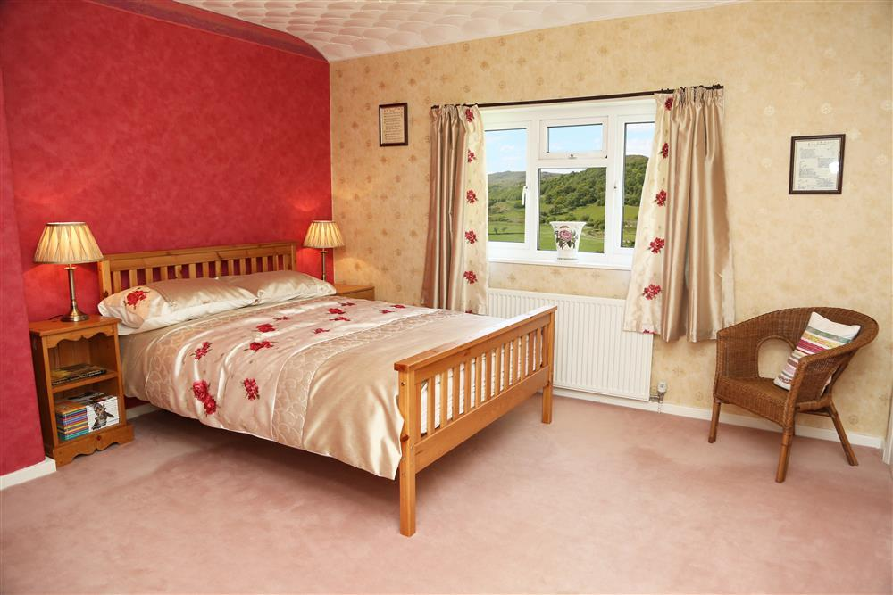 Spacious double bedroom with stunning views