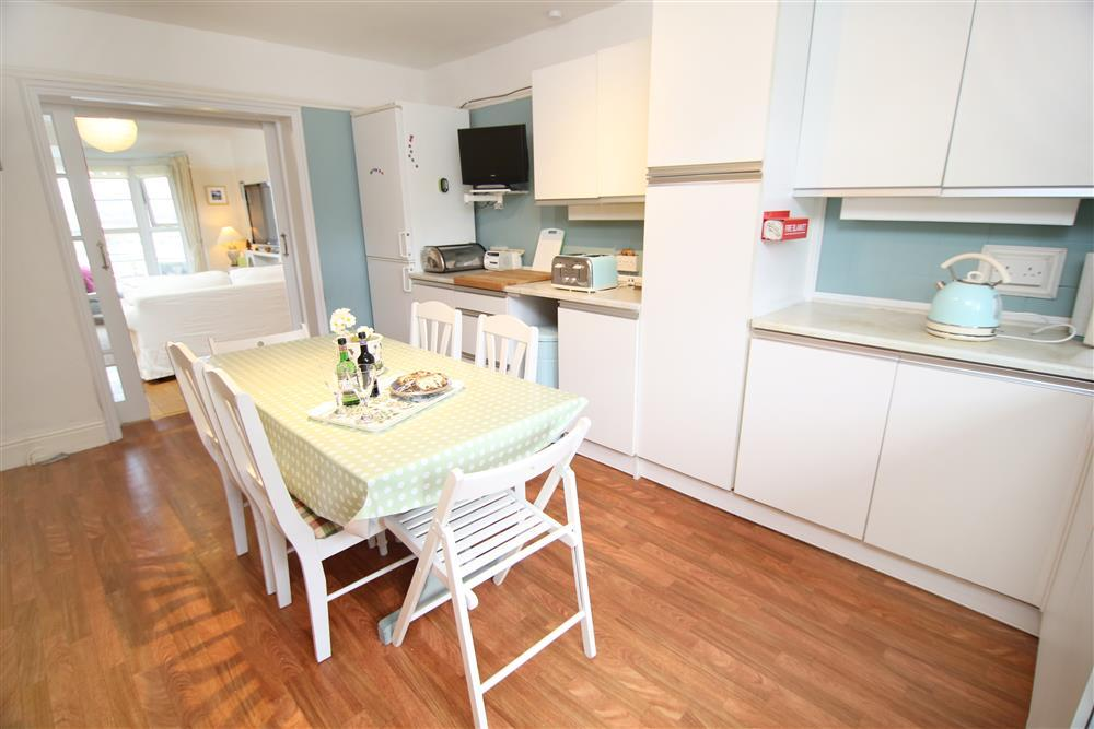 Kitchen with doors through to lounge
