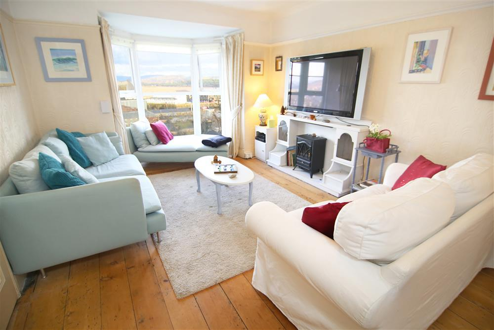 Spacious lounge with stunning views over Porthmadog and Snowdonia