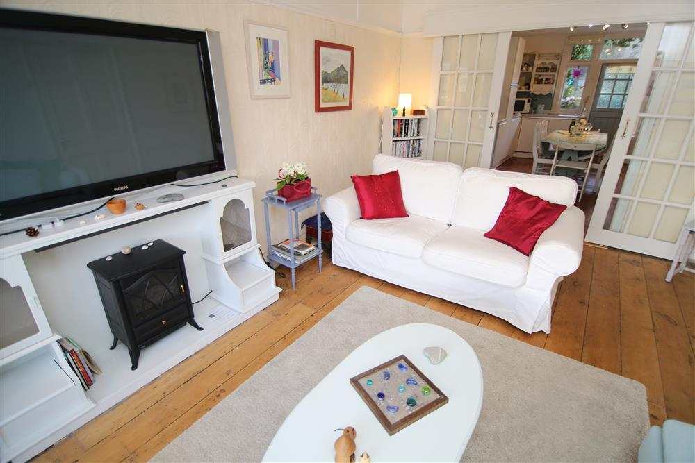 Lounge with doors to kitchen