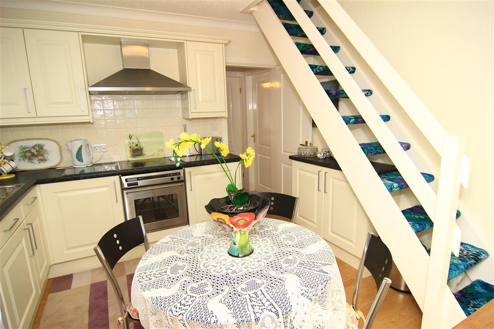 Kitchen and stairs to twin bedroom