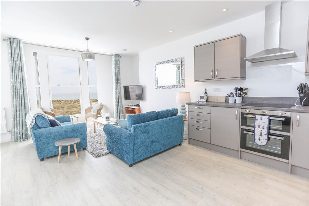 Lounge and kitchen with sea views