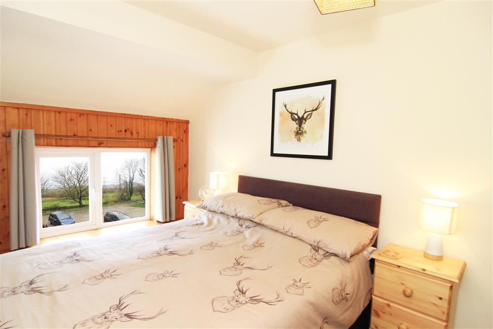 Double bedroom with views of countryside with the hills 'Clogwyn Melyn' and 'Mynydd y Cilgwyn' in the distance.