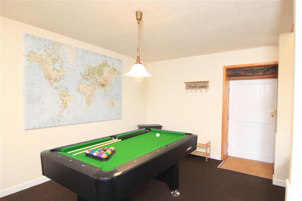 The pool table in the lounge area next to the front door