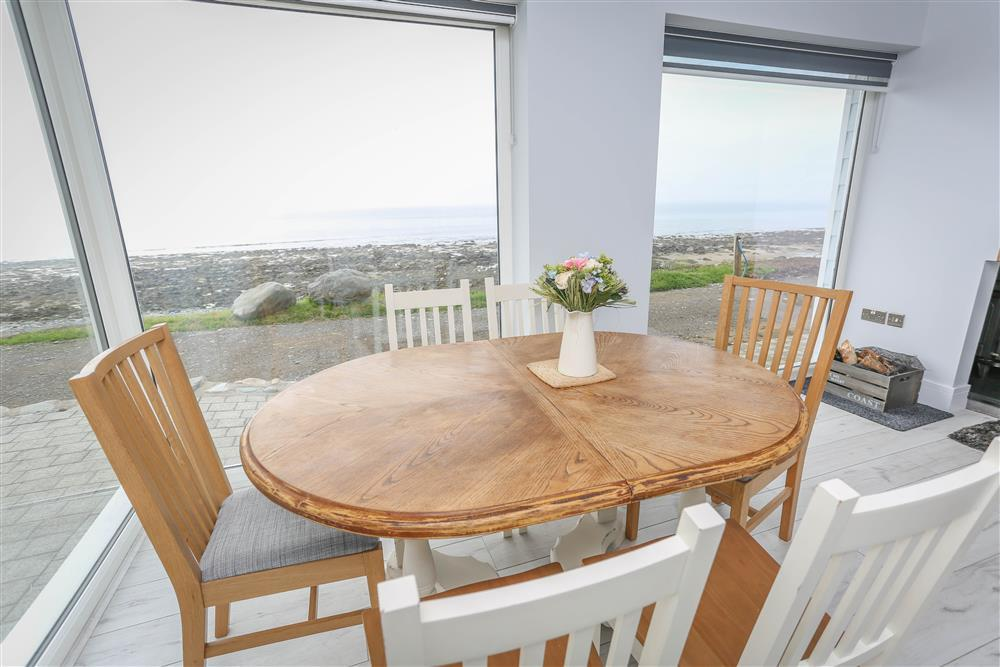 The Dining Area in the Living Room with the view of the sea at low tide.