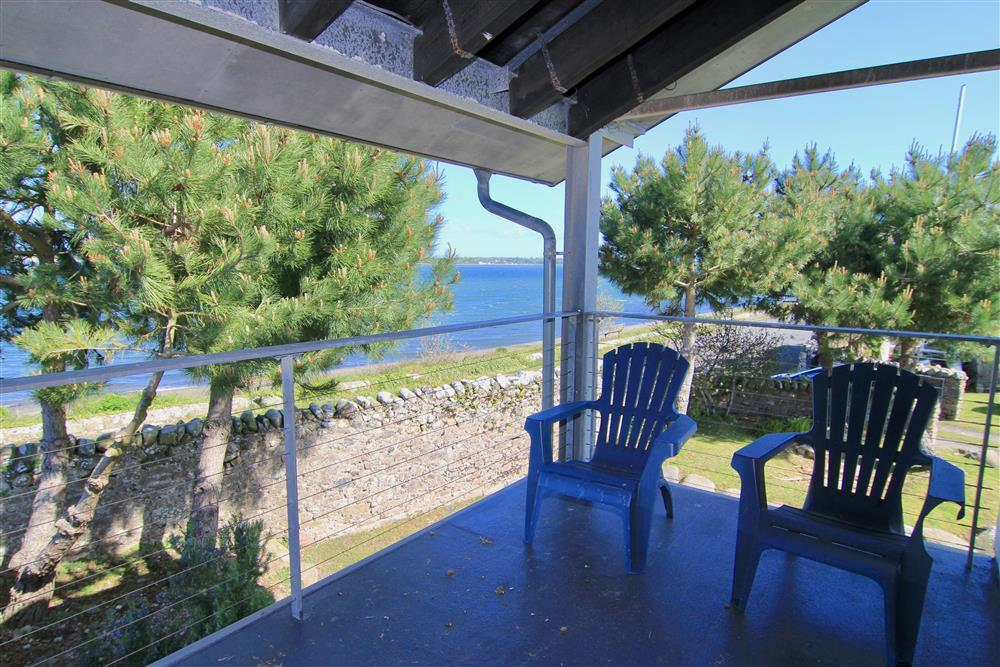 The big balcony at the front of the house
