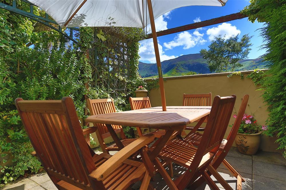 Back garden with views of the mountains Yr Eifl / The Rivals. It has three summits and on a clear days, the views from the top summit reach as far as the Isle of Man, the Wicklow mountains in Ireland and the Lake District.