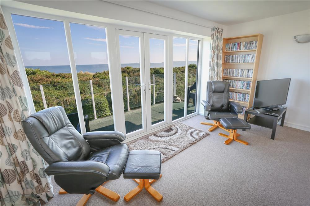 Enjoy stunning views from the lounge with patio doors
