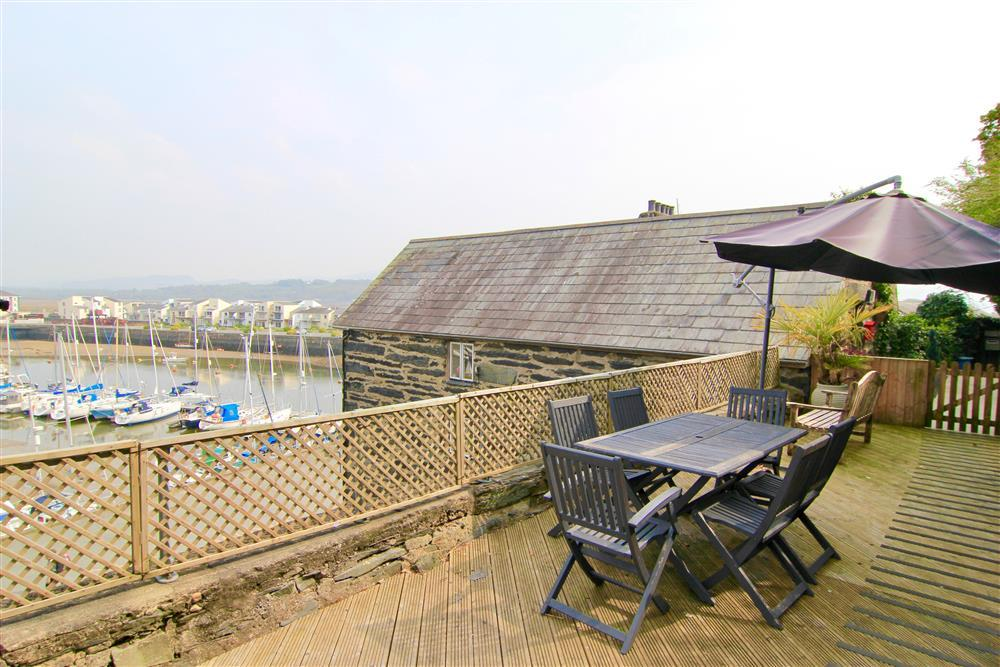 The shared decking area with outside dining area and bench.