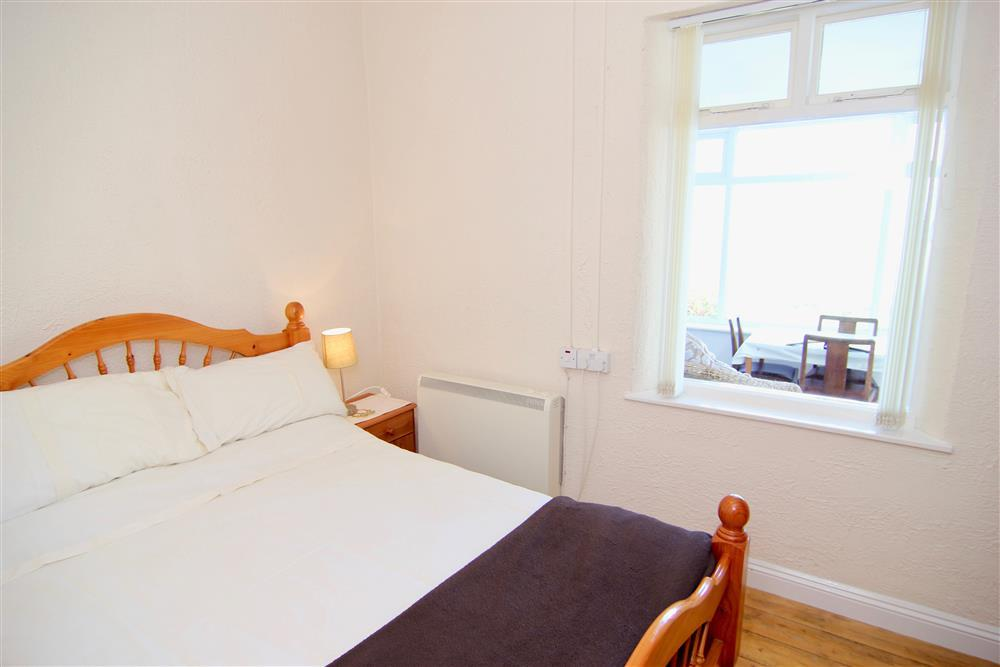 Double bedroom with a window to the Conservatory & Dining room and the sea view.