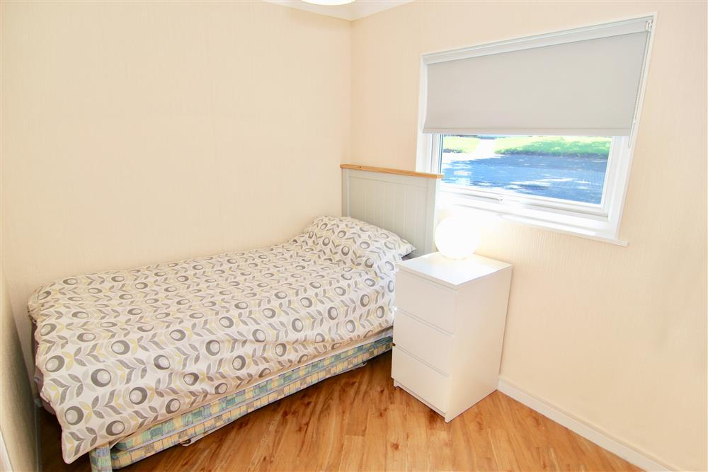 Single bedroom. A pull out bed is available on request. If you need this bedroom to have two single beds then please request it at time of booking.