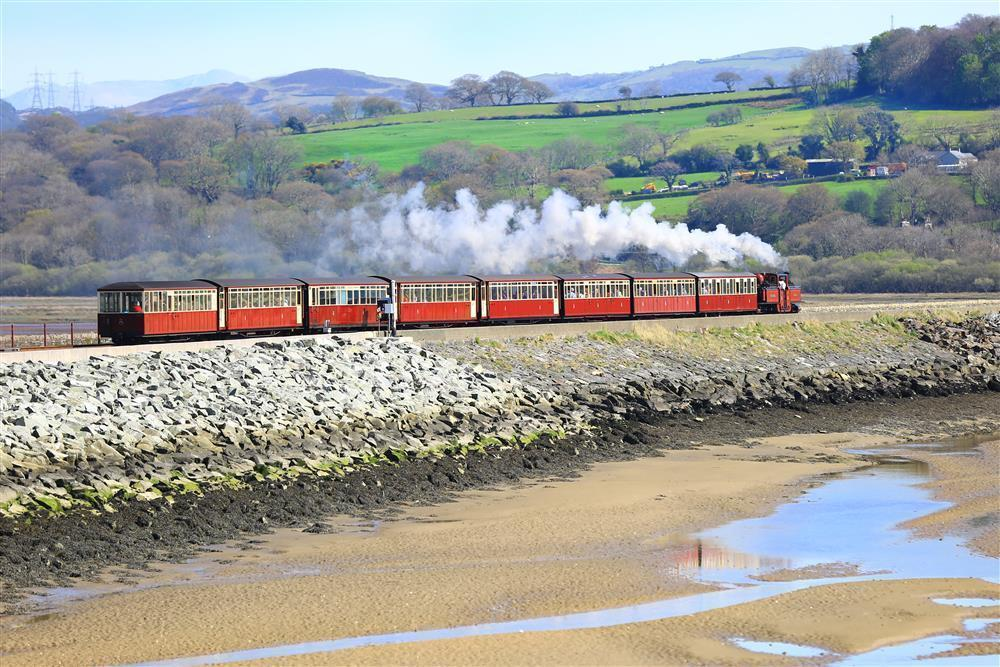 A Steam Train leaving Porthmadog and travelling towards Blaenau Ffestiniog