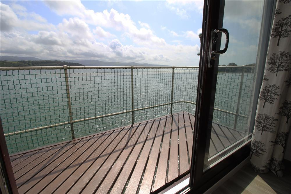 The balcony has views of the Snowdonia mountains and the Dwyryd estuary meeting the sea