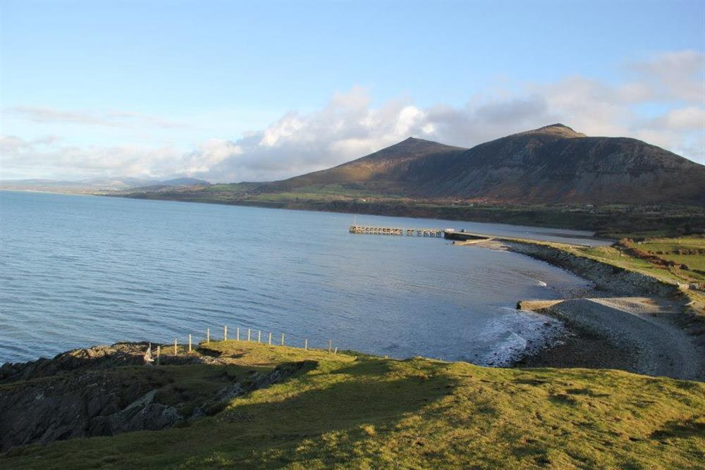 Photo of Trefor Beach and Trefor Pier at high tide.