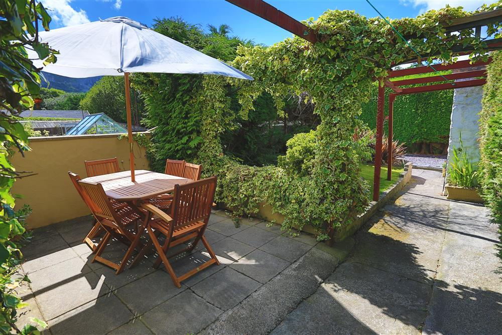 GARDEN: Private patio with outside dining area and lawned garden to the back which can be completely enclosed. Views of the mountain.
