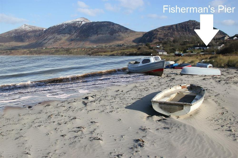 Trefor Beach, you can see Fisherman's Pier holiday home in the right handside of the photo.