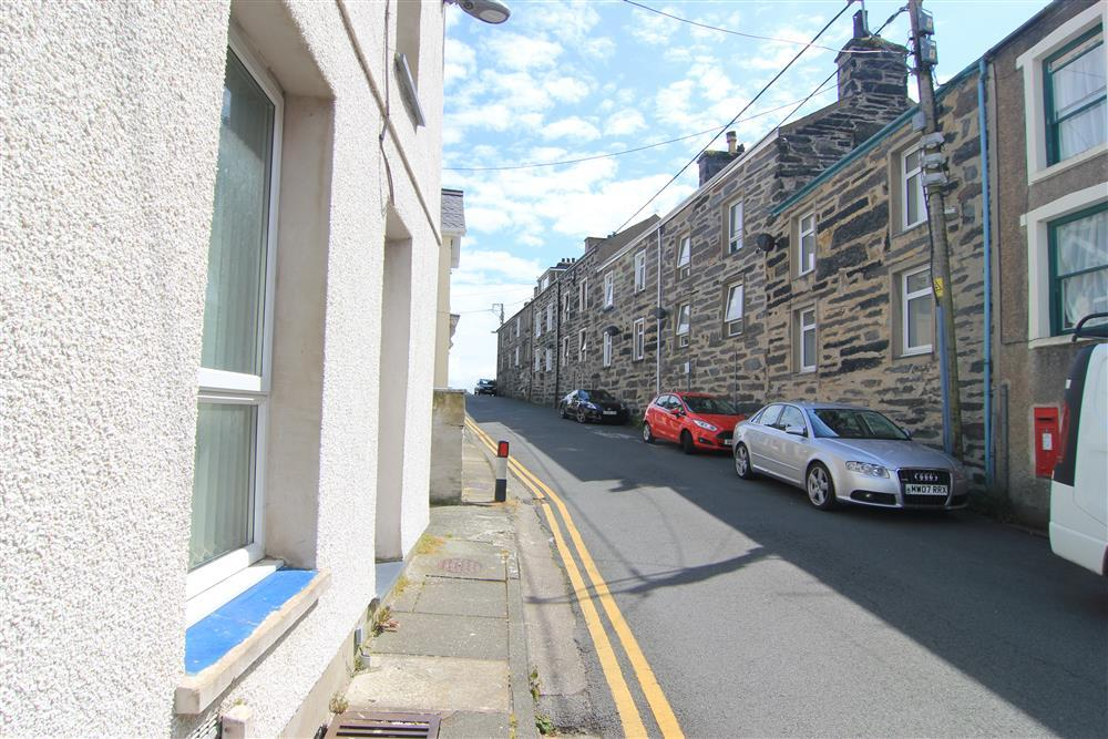 Photo from the front of Harbour Lookout looking at the street parking. You can park on Garth Road right handside. You can also park at Pencei car park (which is at the bottom of the Grisiau Mawr historic steps)