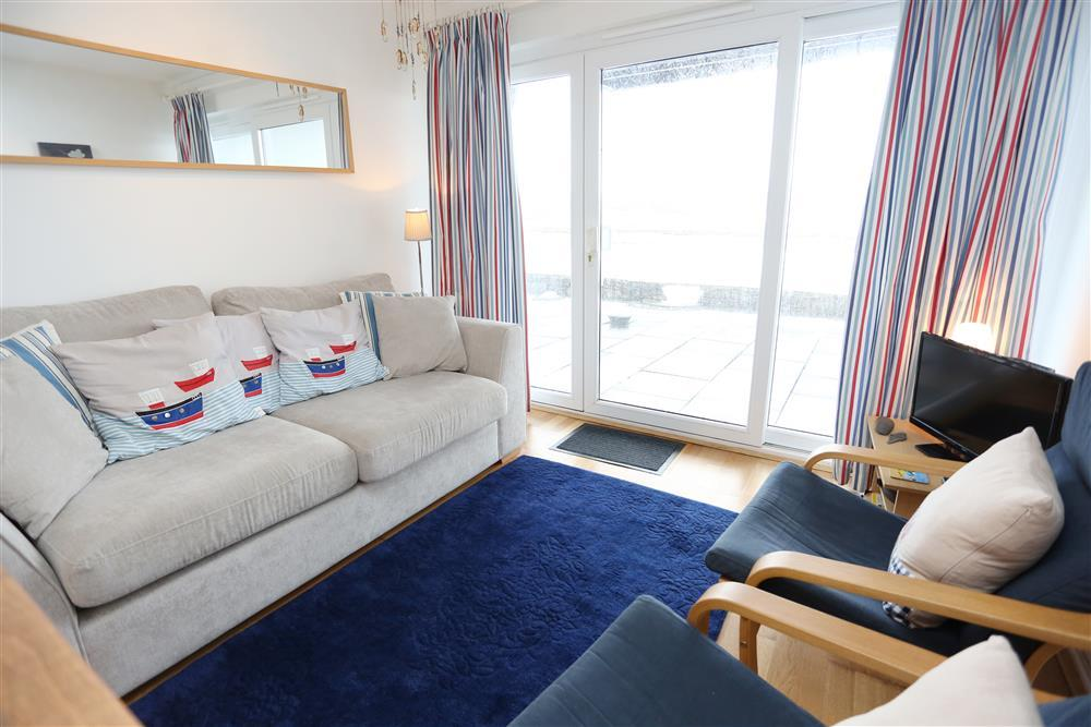 Lounge with comfy seating to enjoy the estuary views