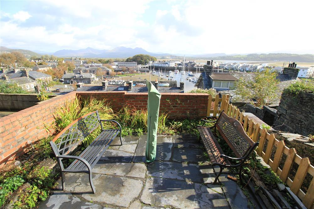 Patio Area with views of Porthmadog Harbour and Snowdonia mountains in the distance. This is the same level as the Kitchen and Dining area.