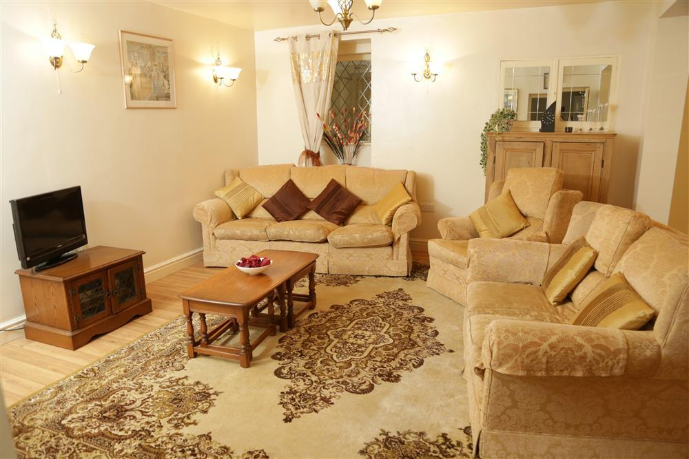 Large and spacious lounge with TV and comfy sofas