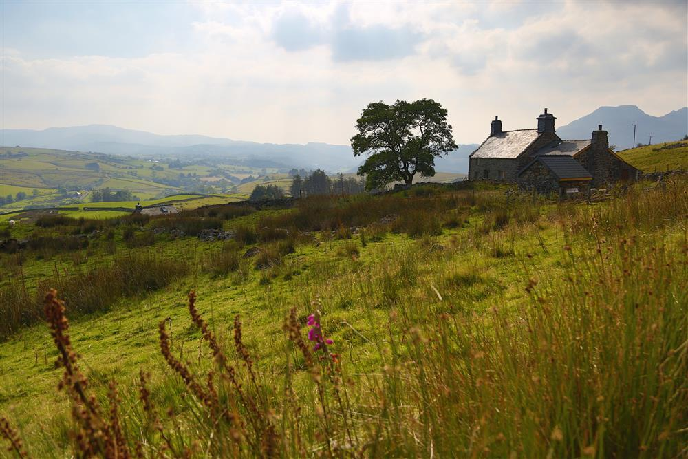 Cae Canol Farmhouse is nestled in the Teigl valley
