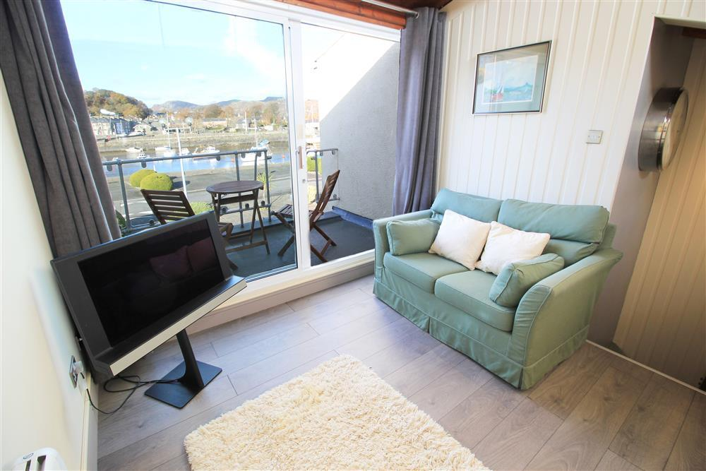 Lounge area looking at the balcony and the view of Porthmadog Harbour (1st Floor)