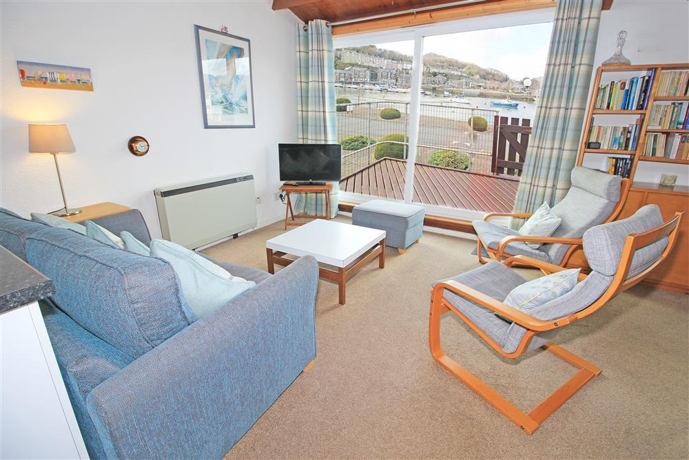 Living Room - Lounge area with large patio doors to enjoy the views over the harbour (1st Floor)