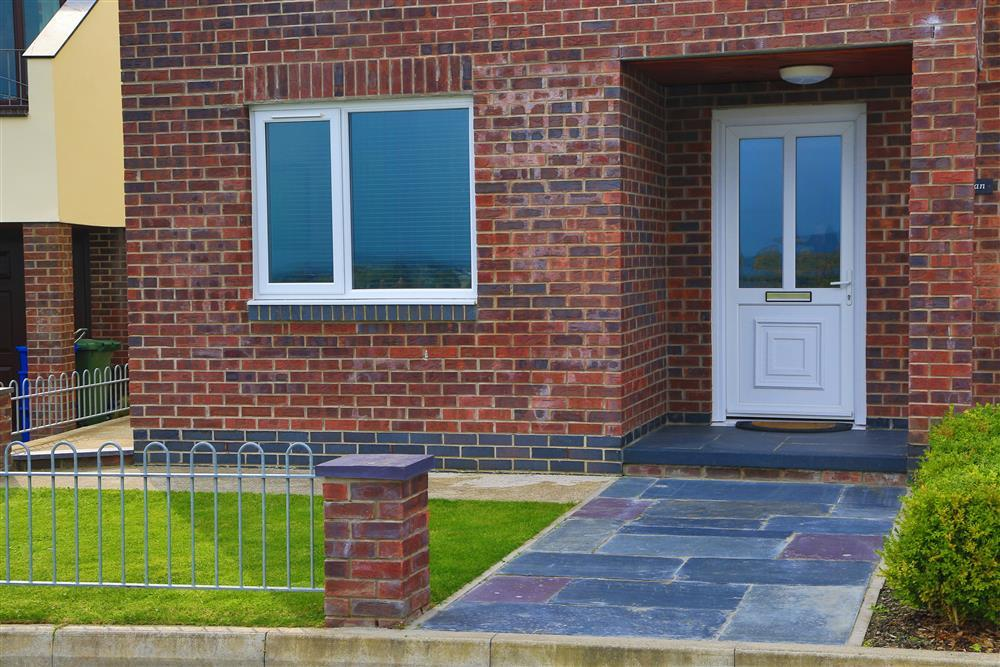 Front door and small lawn at the front of Dizzy Heights