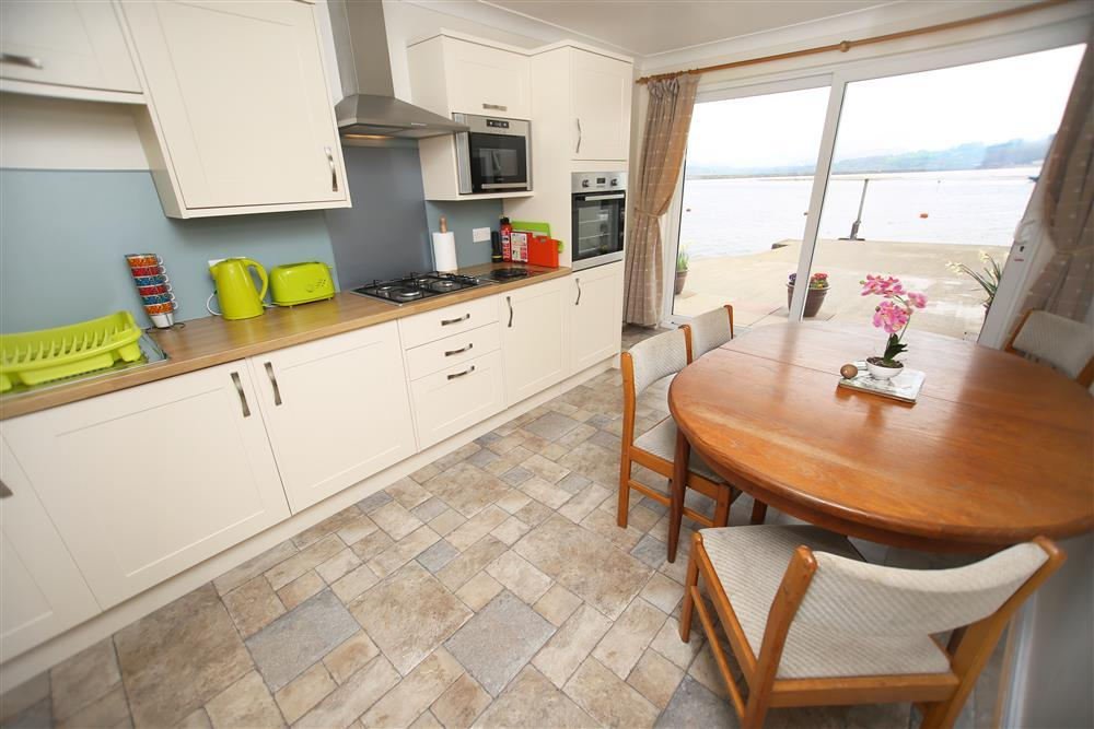 Kitchen / diner with doors out to patio overlooking harbour - stunning views!