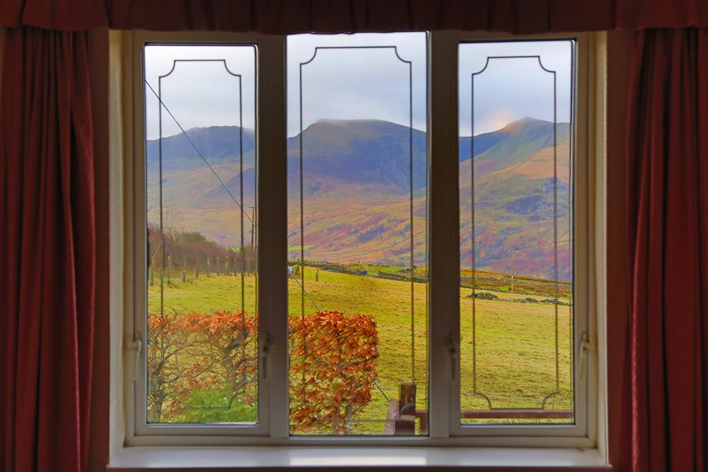 Bedroom 1 stunning views of the Natlle Rdige mountains in Snowdonia.