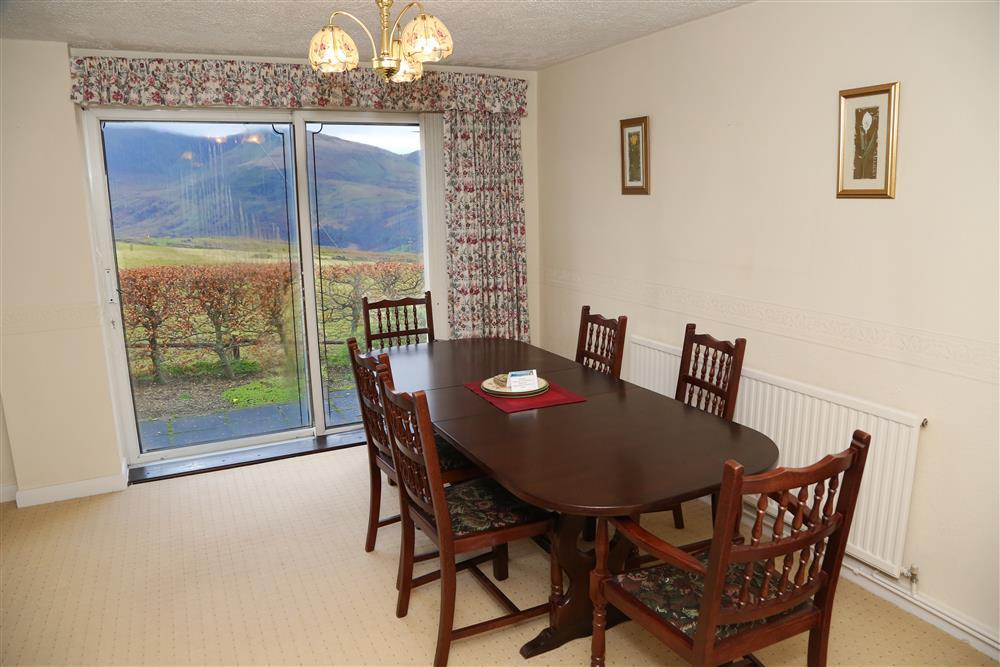 Dining area off the living room with views of the Natlle Ridge. The Natlle Ridge is a name given to a 9 km range of Snowdonia mountains.