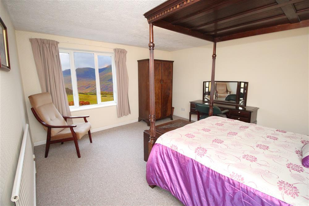 Bedroom 1: Double bedroom with views of the Natlle Ridge mountains.