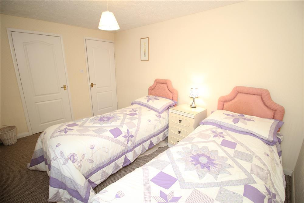 Bedroom 2: Two small single beds (2 feet 6 inches wide and 6 feet 3 inches long). They're the same length as a single bed, just narrower.