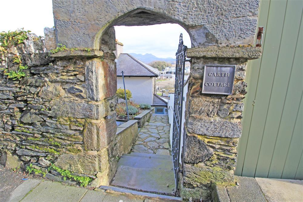 Photo from the road of the gate into the back garden of Garth Cottage.