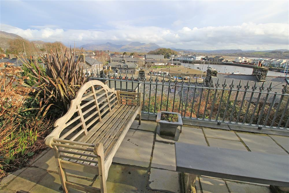 Stunning mountain and sea views from the front patio area with 2 benches
