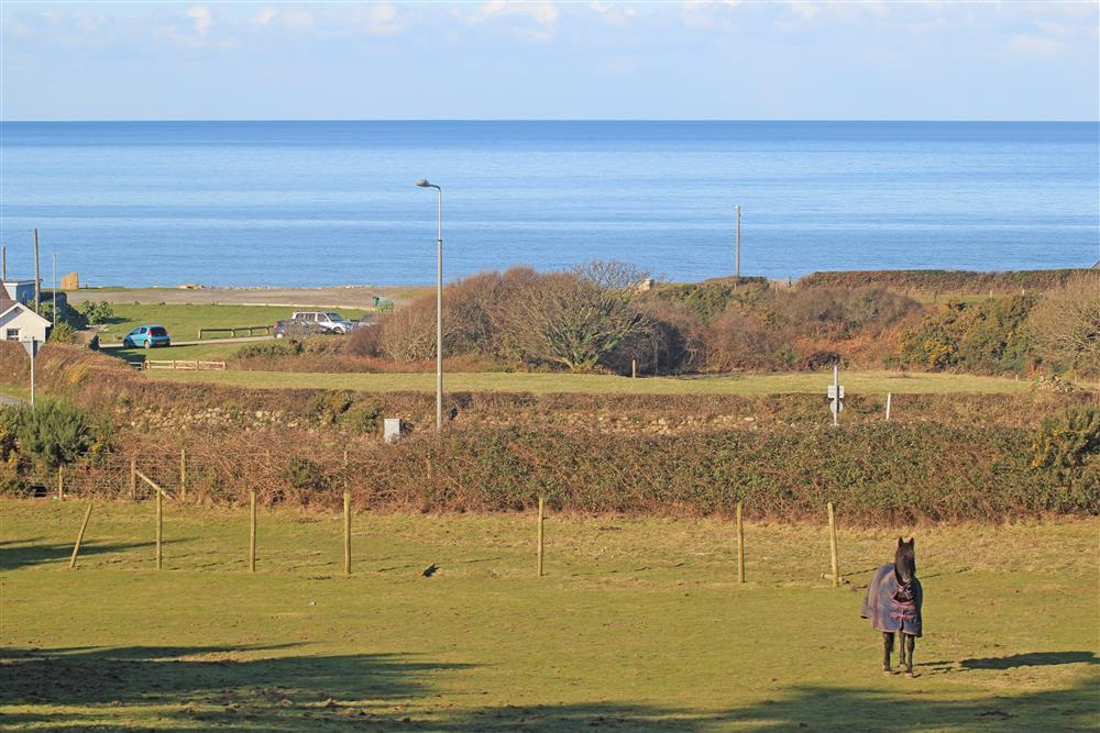 Close up photo of the sea view from the summer house. Aberdesach beach is only 7 minutes walk away (0.4 mile)  from Garden Chalet