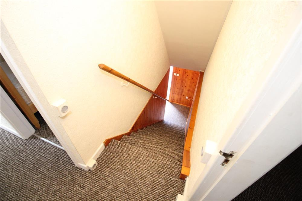 Photo taken from the 1st floor landing looking down at the staircase to the 1st bedroom only.