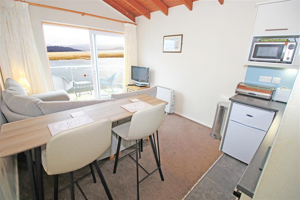 Living Room - Kitchen area looking at the lounge area and view