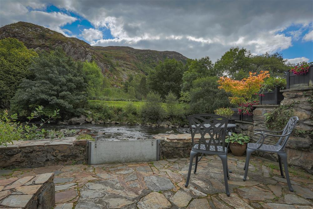 Enjoy the river and mountain views from your own private patio