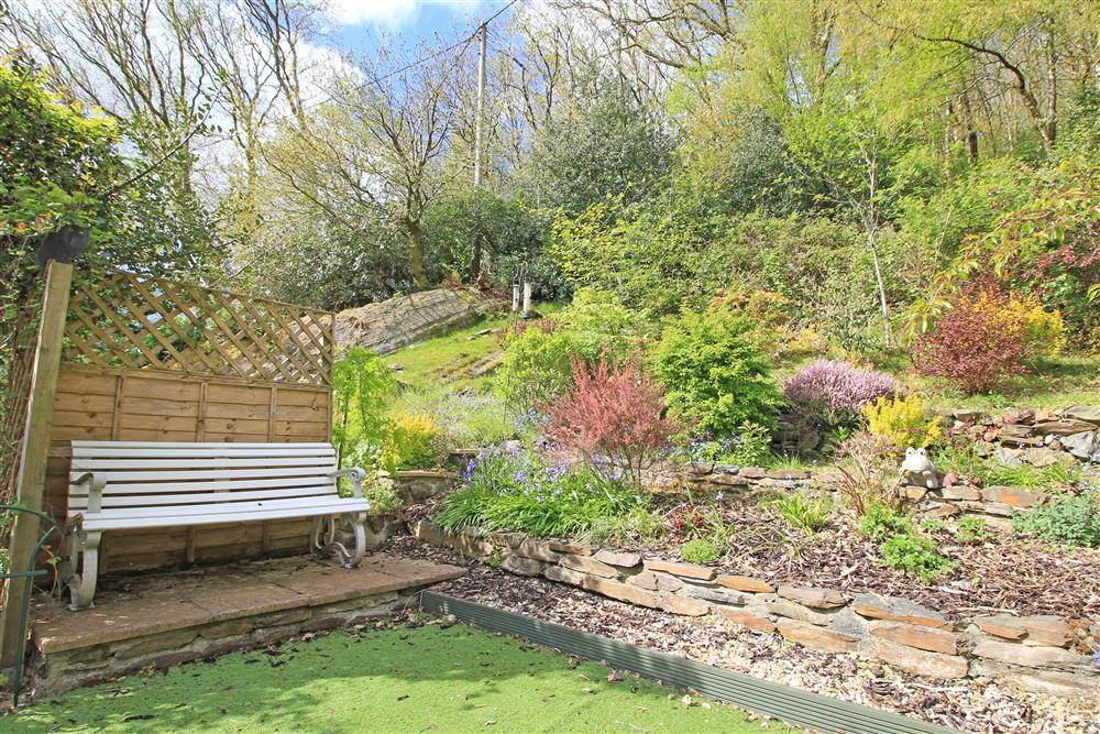 Big back garden with outside bench. This amazing garden has access to the woodland above.